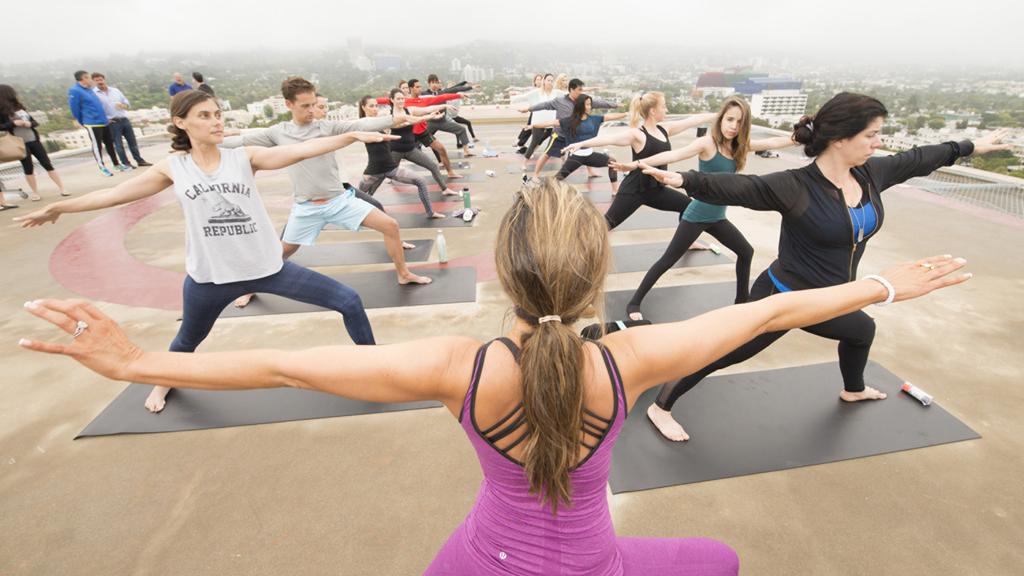 Yoga in the Sky: Celebrity Yogi Rainbeau Mars Leads Sunrise Yoga On Helipad At Four Seasons Hotel Los Angeles At Beverly Hills For Global Wellness Day