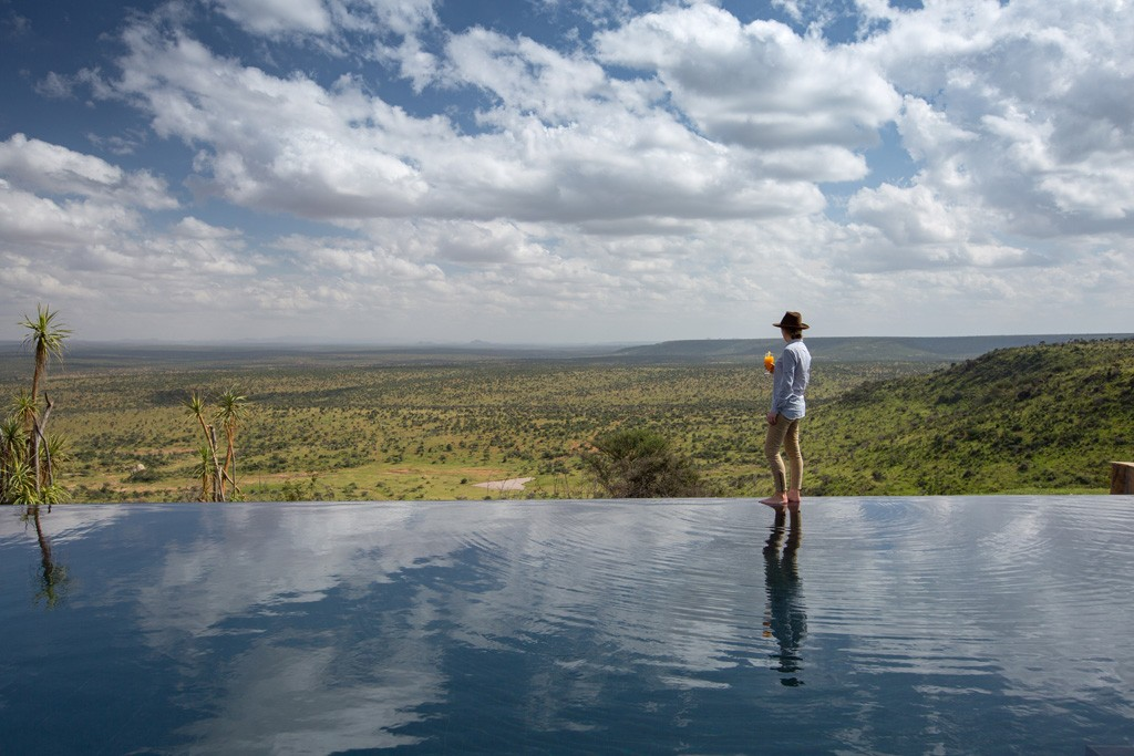 Loisaba_Tented_Camp_infinity_pool_with_lady_and_view